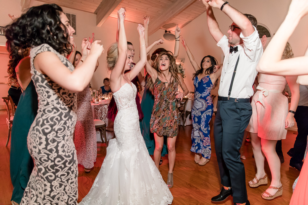 bride and groom dance with their guests