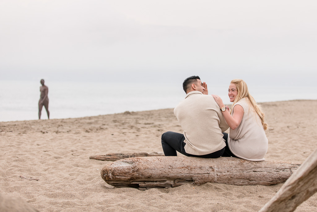 engagement picture photobombed by a nude guy