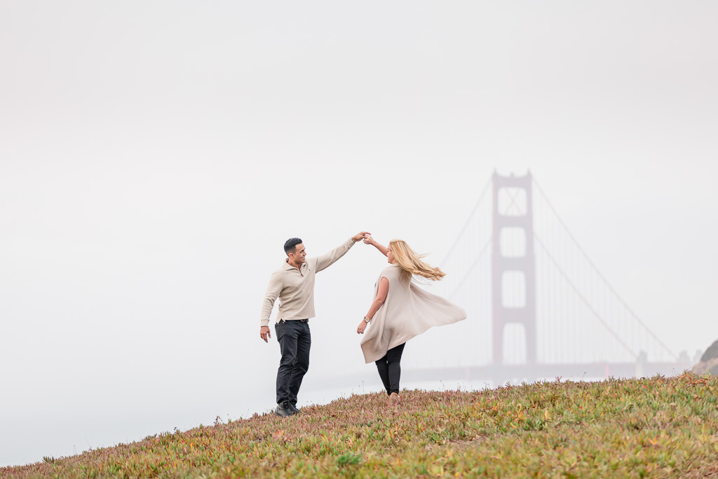 dancing in front of the grand golden gate bridge