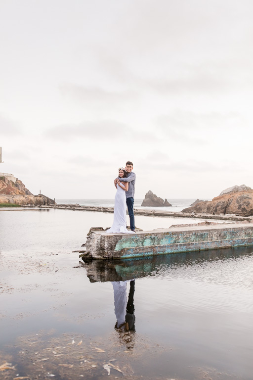 couple photo by the water with reflection