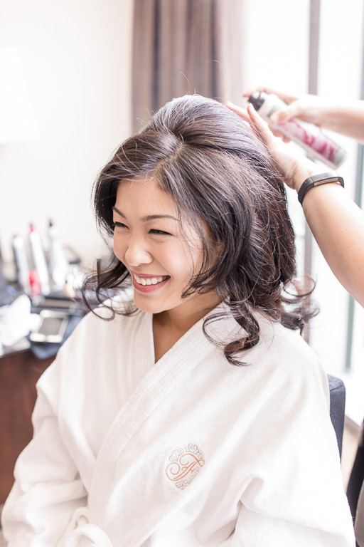 bride having her hair done in the fairmont pittsburgh robe