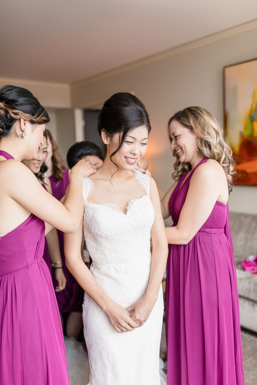 bride getting into her dress at fairmont pittsburgh bridal suite