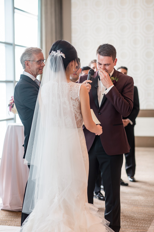 groom got emotional when reading his vows