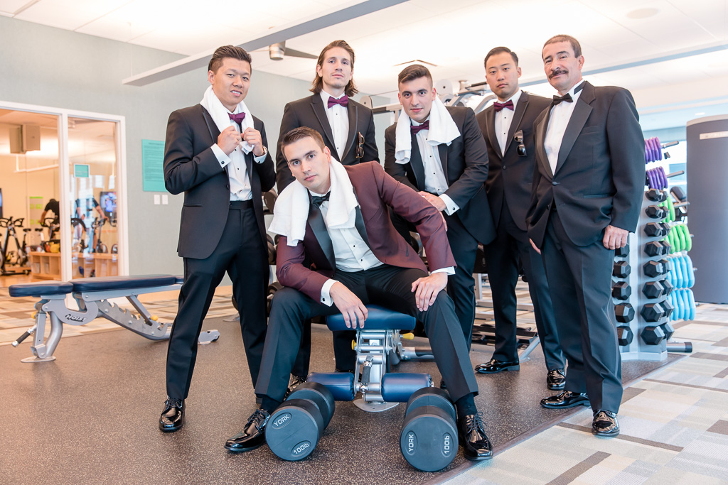 funny groomsmen photo at the gym