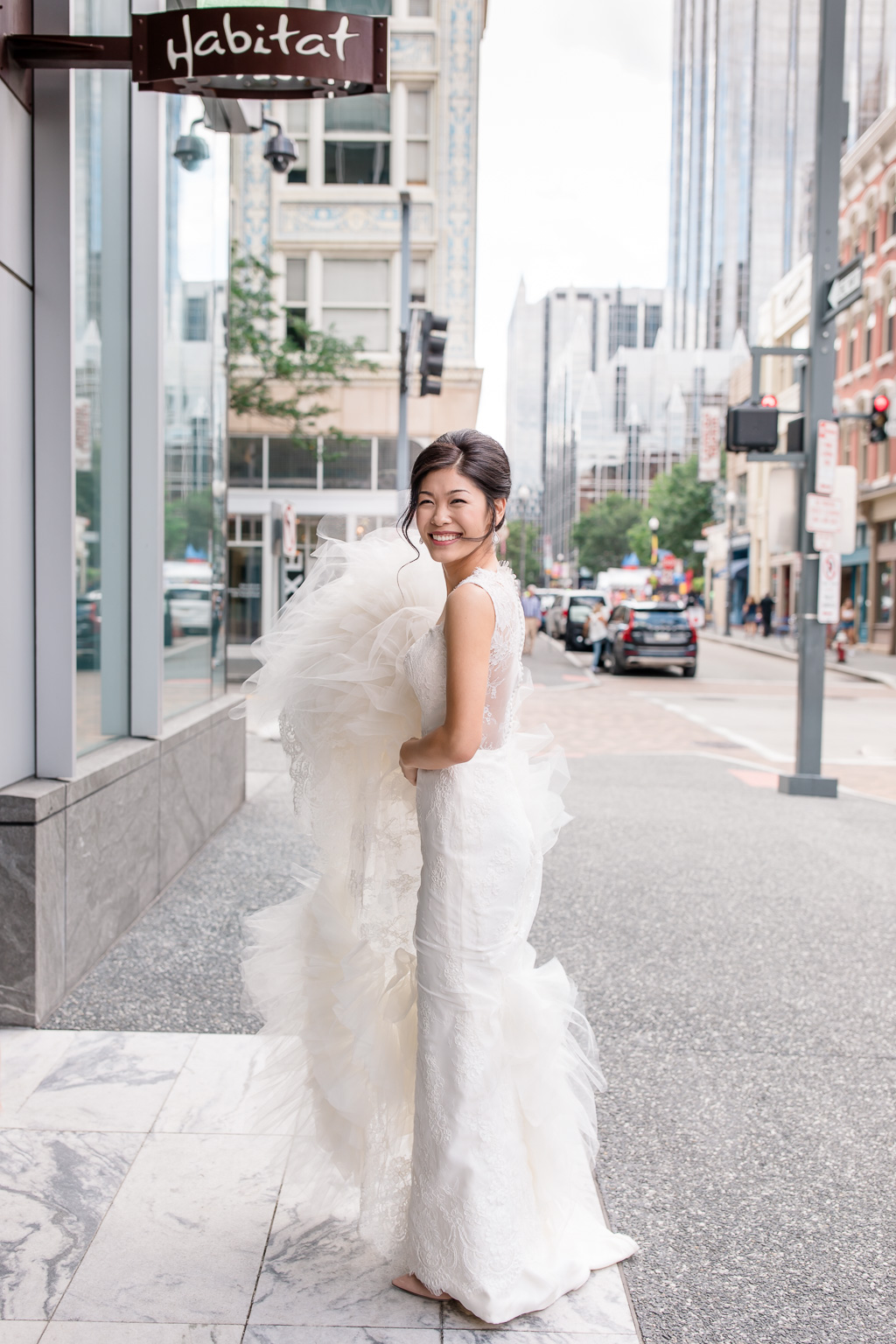 a candid photo of the bride outside fairmont pittsburgh lobby