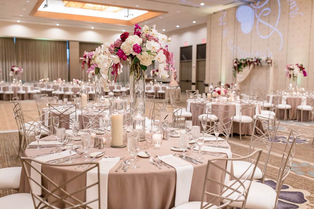 fairmont pittsburgh wedding reception setup with tall floral centerpieces
