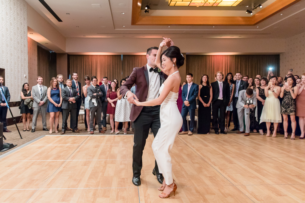 bachata first dance in a white jumpsuit