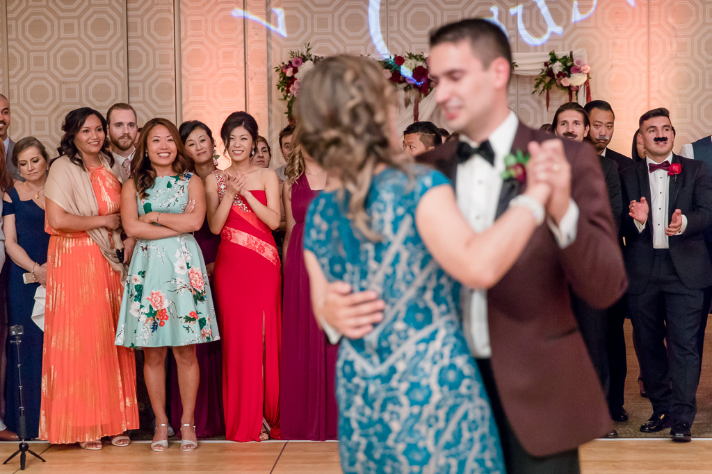 bride's reaction to groom and mother dance