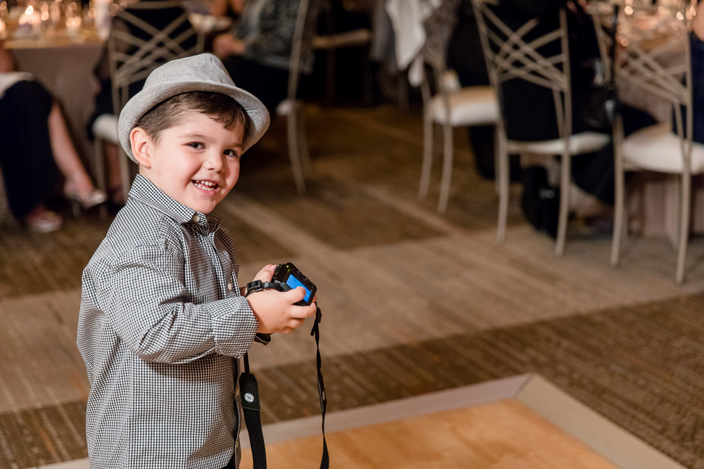 funny wedding guest - little photographer in the making