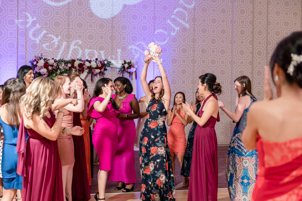 the girl who got the tossing bouquet - priceless reaction