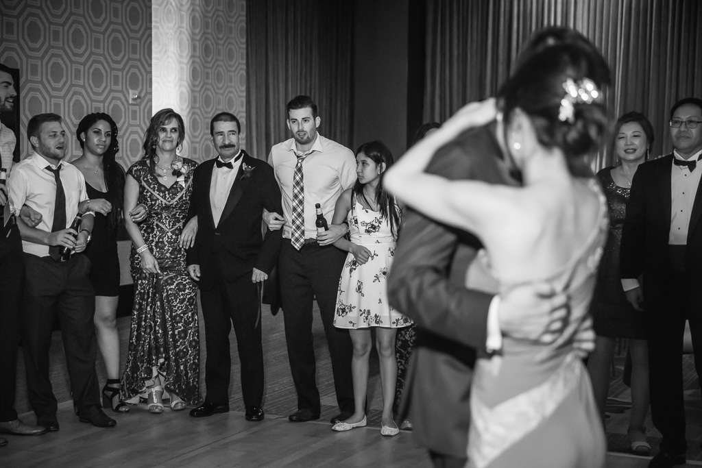 parents' reaction during an emotional bride and groom dance