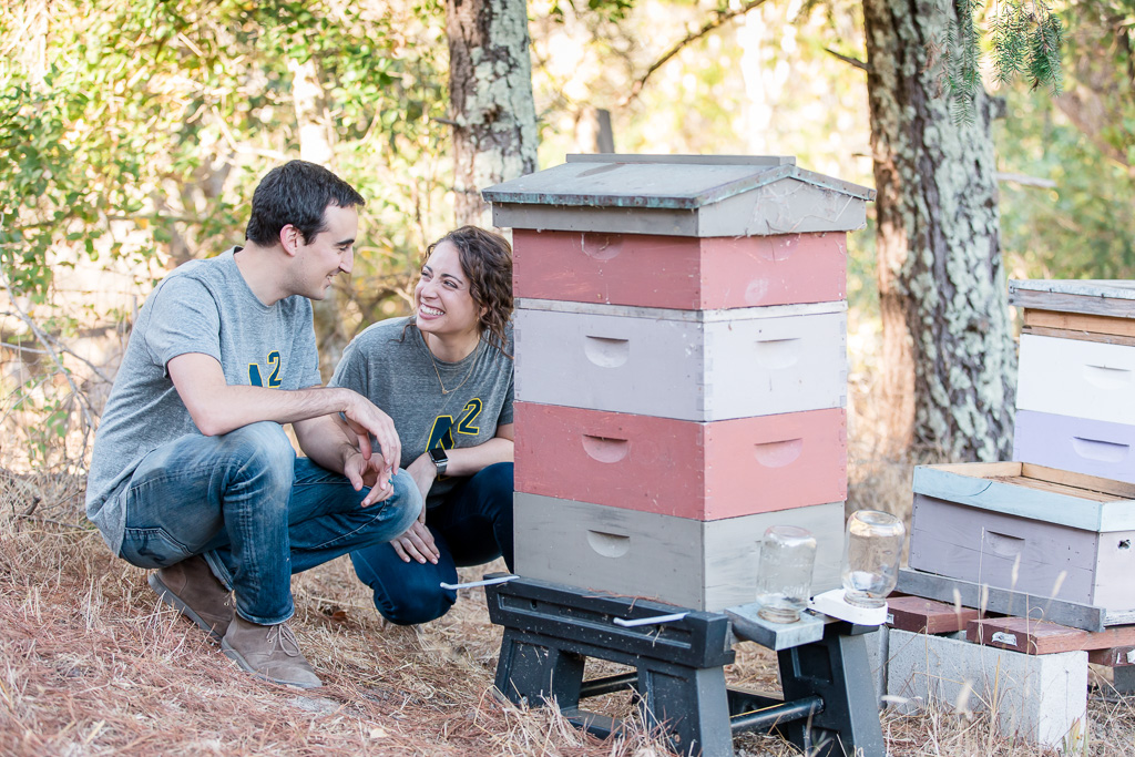 couple with their bee hives