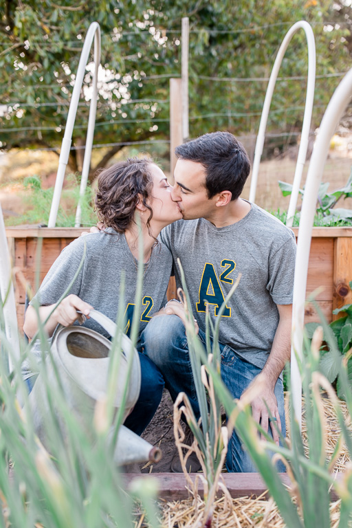 cute engagement photo taken at couple's vegetable garden