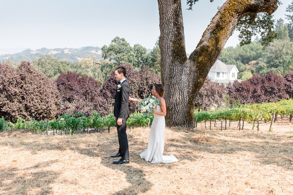 a cute first look on a scenic hill overlooking the mountains