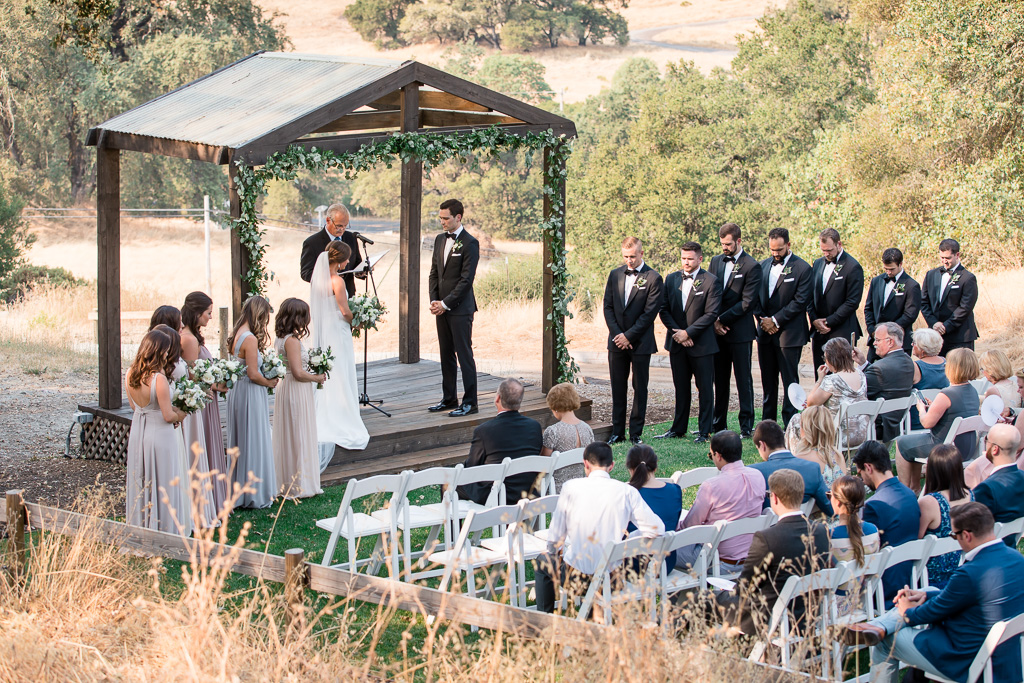 outdoor wedding ceremony surrounded by the mountains and vineyards