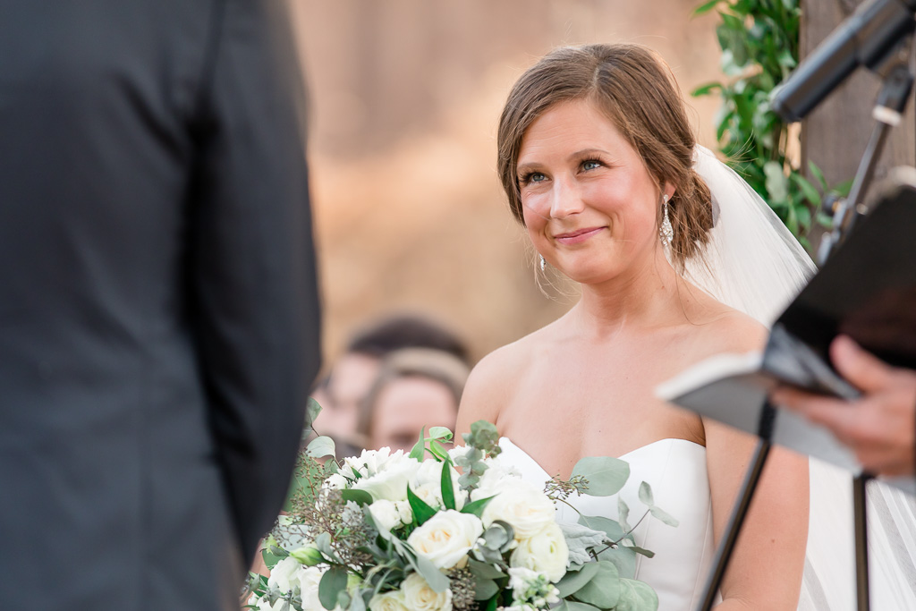 bride looking lovingly at groom during sonoma wedding ceremony