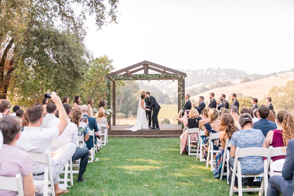 bride and groom's first kiss as husband and wife - Sonoma real weddings