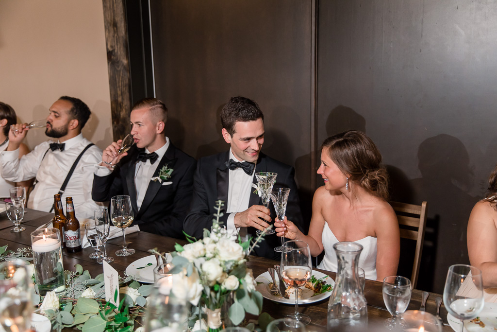 bride and groom enjoying their food and drinks