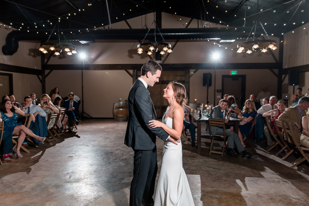 a romantic first dance inside the barn