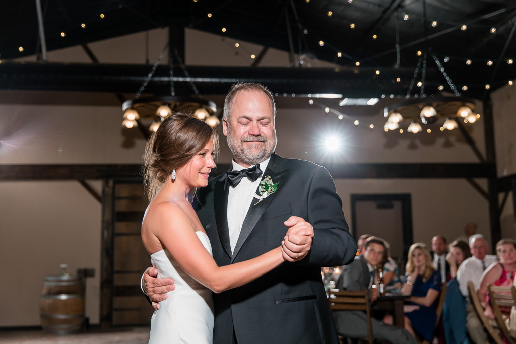 an extremely emotional father daughter dance during the wedding reception at the highlands estate
