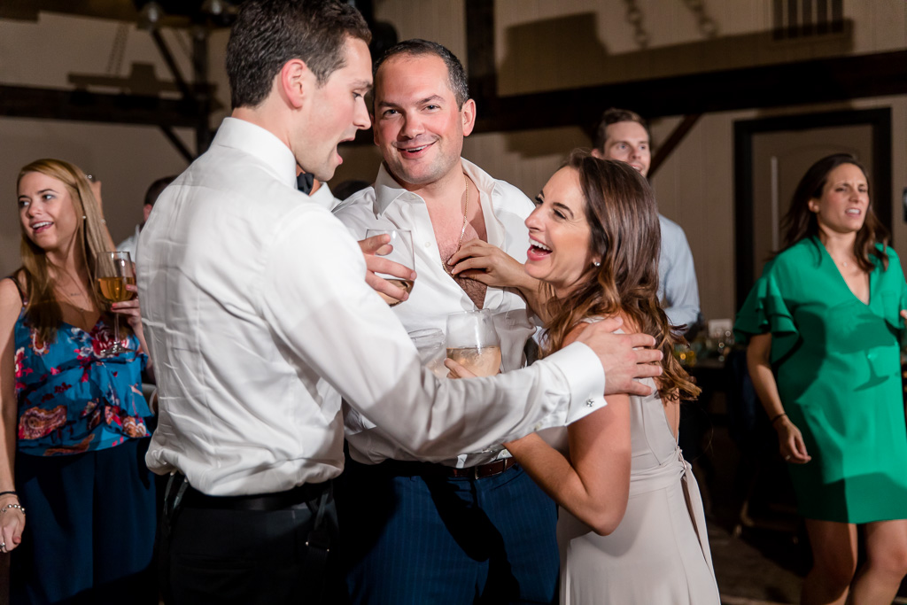 bridesmaid hilariously pulling chest hair from her husband