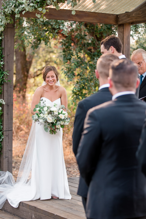 officiant said something funny and bride bursted out laughing at the ceremony