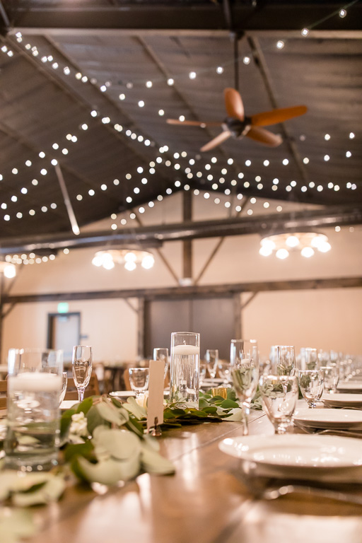 floating candles and string lights for a beautiful barn wedding reception