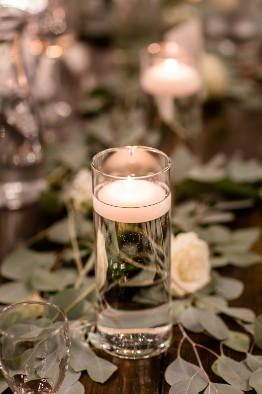 floating candles and leaves wedding ceterpiece