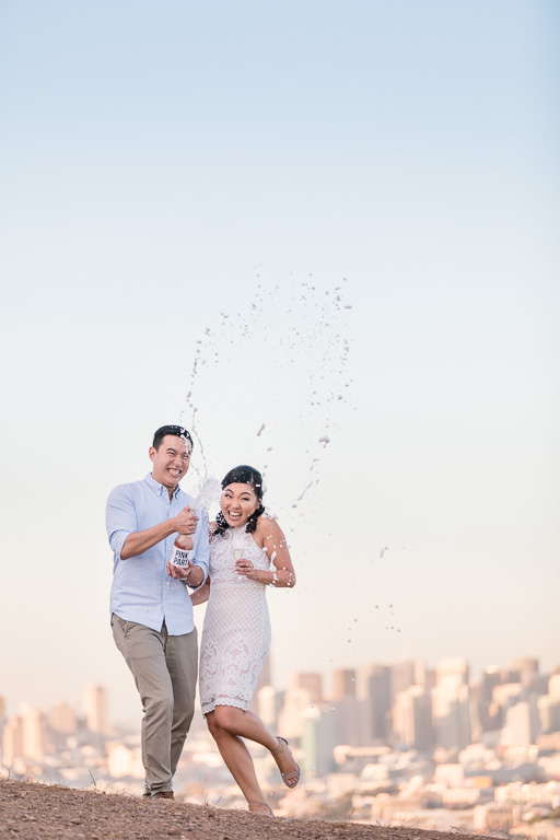 champagne shooting out of bottle engagement photo idea