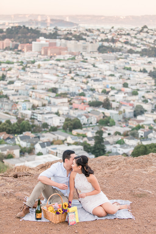 romantic picnic setting engagement photo in San Francisco with city skyline