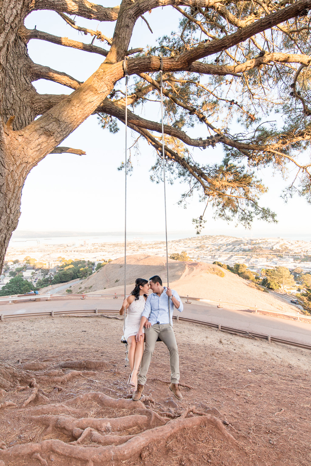 engagement photo at Bernal Heights tree swing