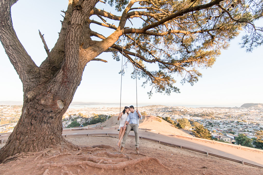pretty photo of couple on Bernal Heights wooden swing