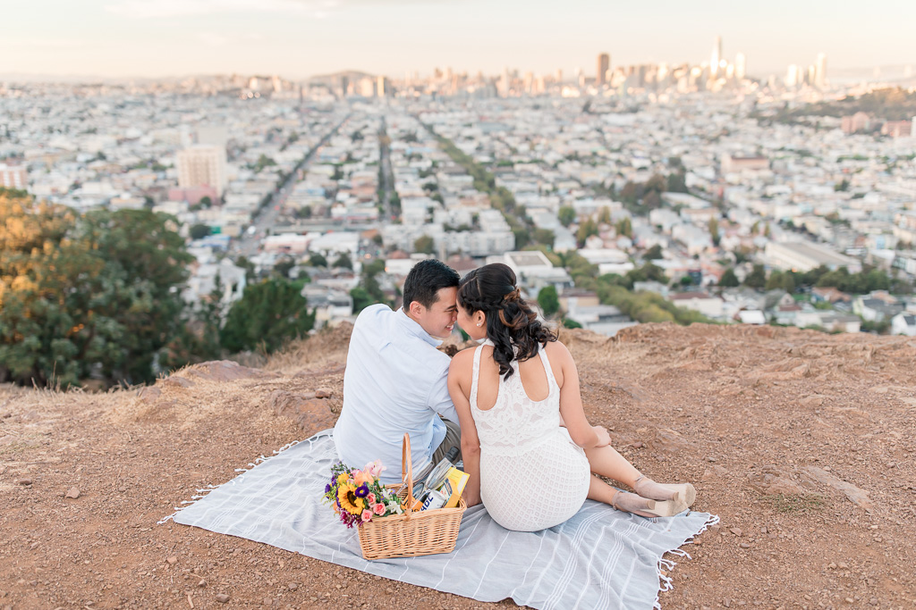 cute couple looking down on a San Francisco urban sunset