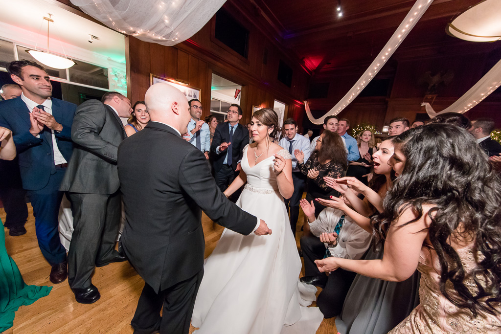 newlyweds dancing while live band is playing
