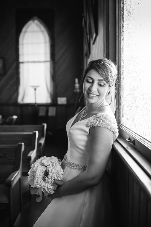 black and white portrait for the bride inside the cute tiny church
