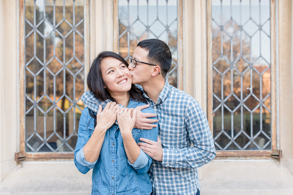 sweet couple have their photos taken on their beautiful campus