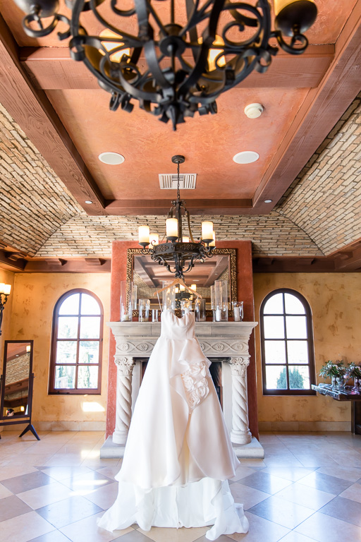 wedding gown hanging in the bridal suite at regale winery