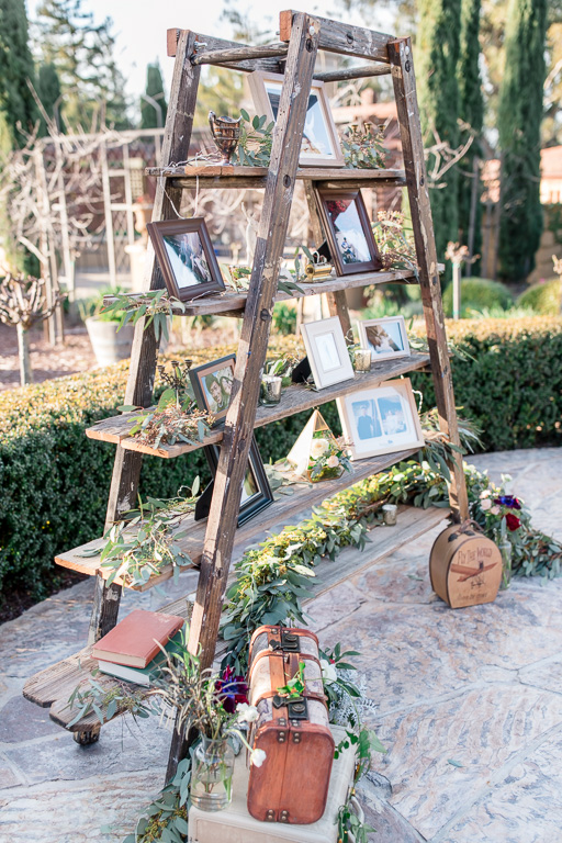 wooden rustic ladder beautifully decorated with picture frames at Regale winery