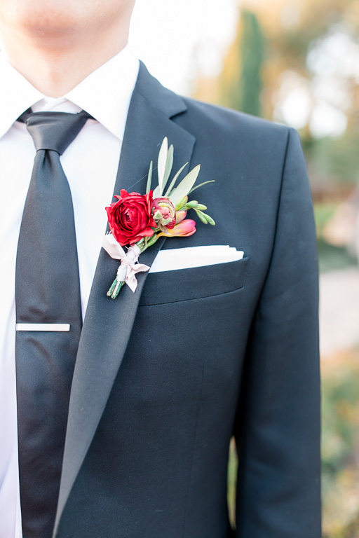 red and cream wedding boutonniere closeup