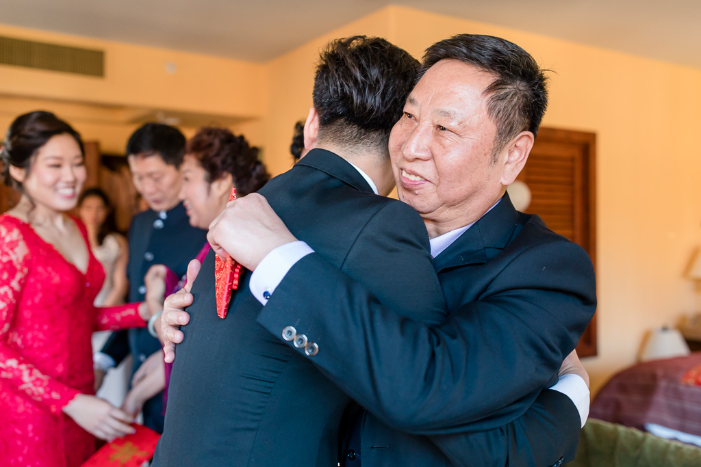 groom hugging his father