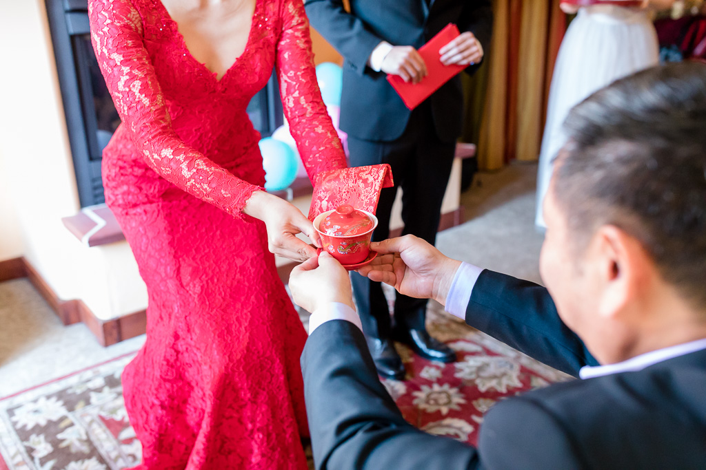 bride receives red pocket from father-in-law