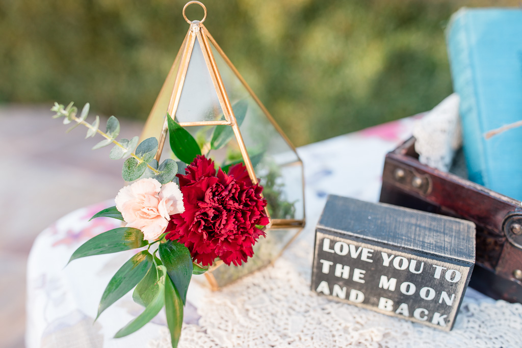 pretty little floral arrangement on the sign in table