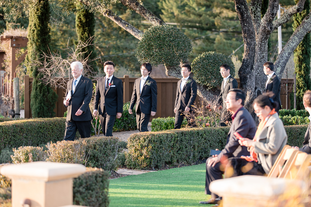 groom and groomsmen walking down for ceremony