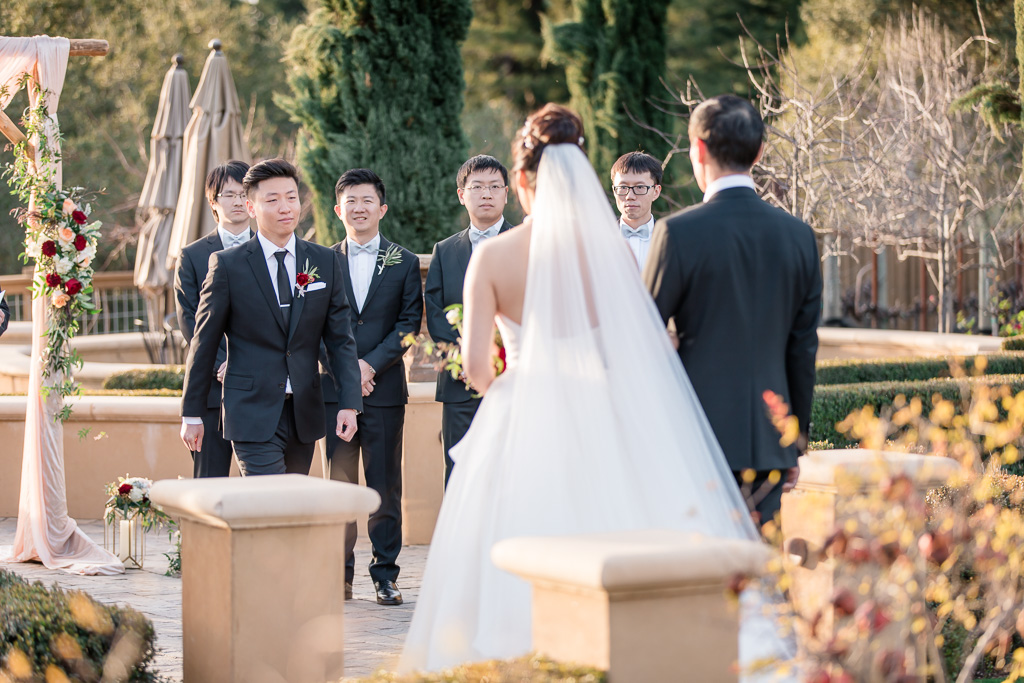 groom walking toward his bride during the ceremony