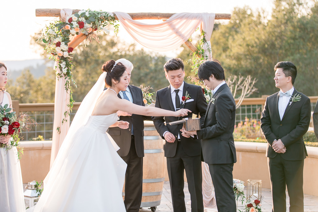 sealing their vows in a wine box