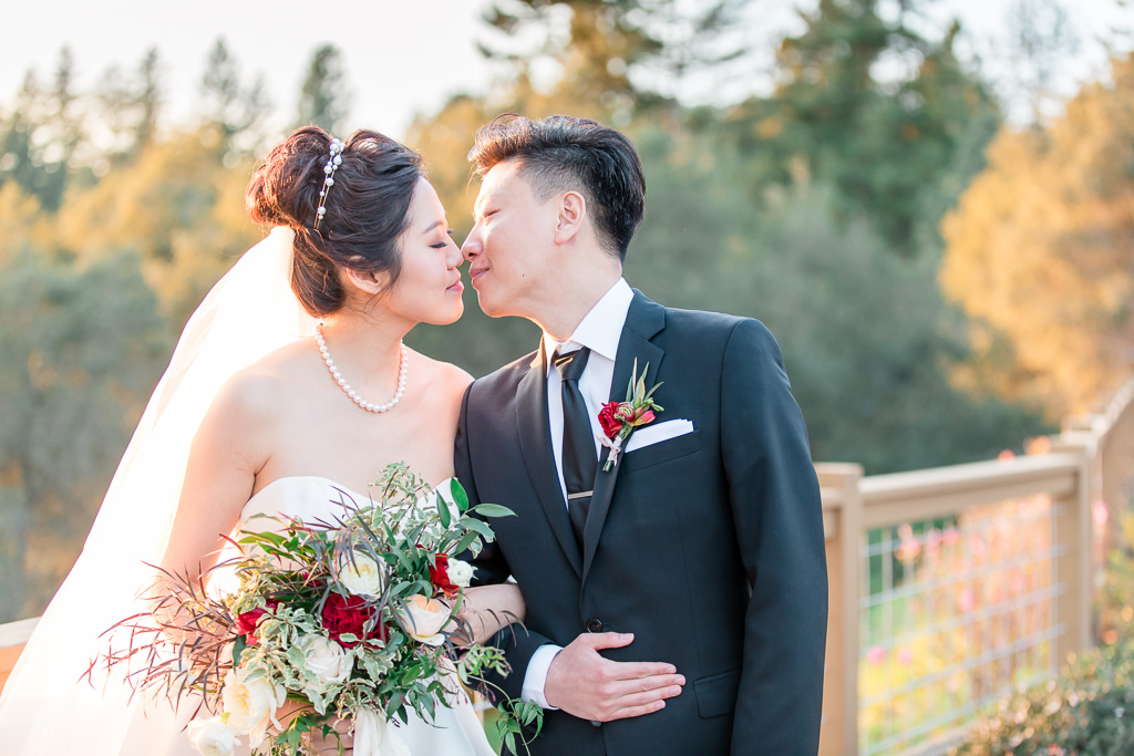 a kiss under the golden sunlight at Regale Winery