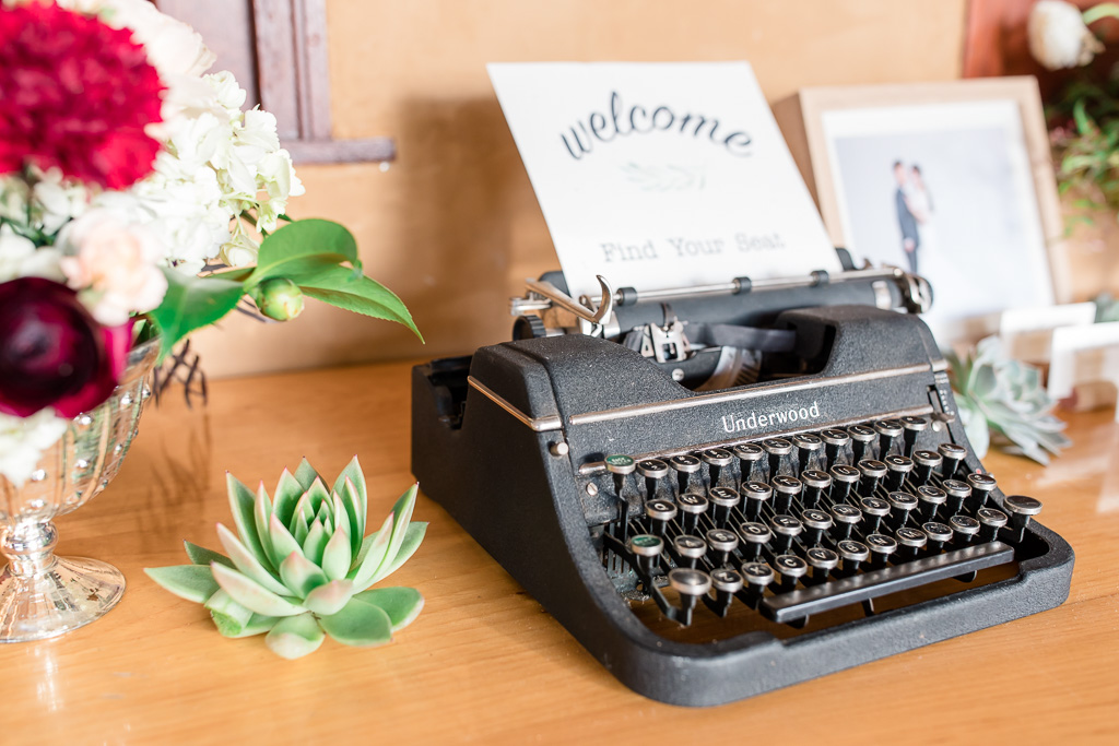 wedding vintage typewriter on the place card table