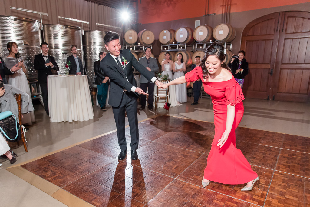 newlyweds first dance in the barrel room at regale winery