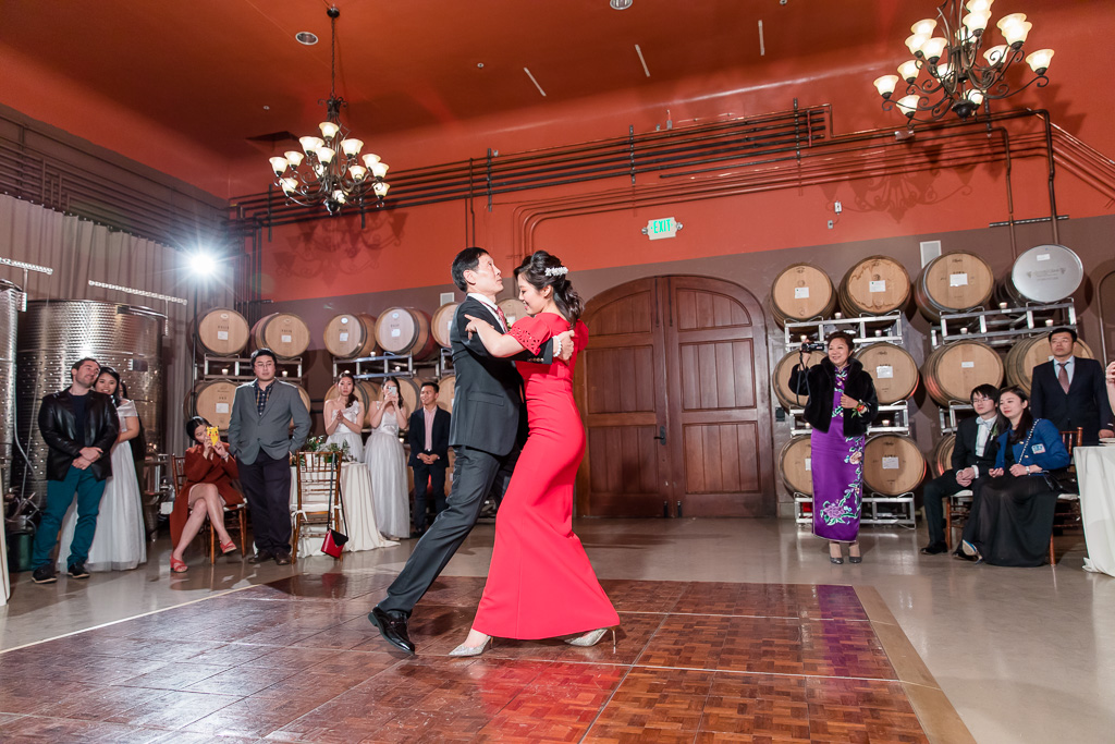 bride dancing with her father in the barrel room