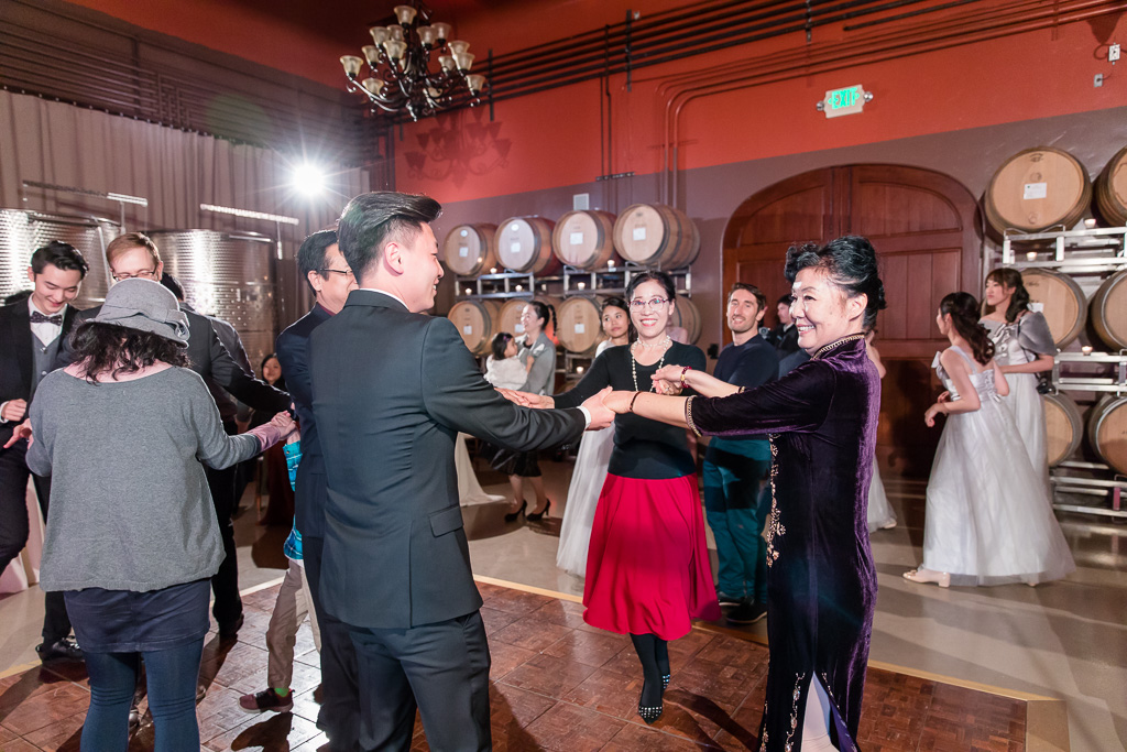 groom dancing with his family